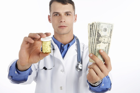 Portrait of Doctor Holding Money and Pills