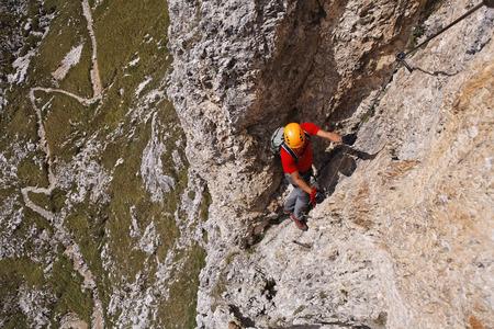 sella: Man Climbing Brigata Tridentina Via Ferrata, Sella Massif, Dolomites, Italy