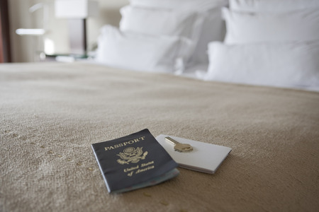 bedspread: Key and Passport on Bed in Hotel Room, Barcelona, Spain LANG_EVOIMAGES