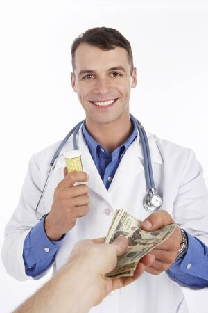 Doctor Exchanging Pills For Money LANG_EVOIMAGES