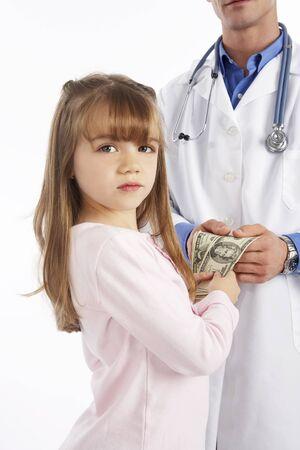 Girl Handing Money to Doctor