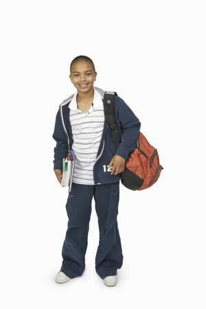 Boy with School Bag and Books LANG_EVOIMAGES