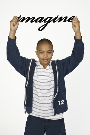 casual clothing 12 year old: Boy Holding Imagine Sign LANG_EVOIMAGES
