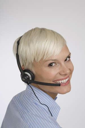 Portrait of Woman wearing Telephone Headset