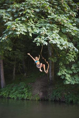 Teenage Girl Jumping Into Lake, Near Portland, Oregon, USA LANG_EVOIMAGES