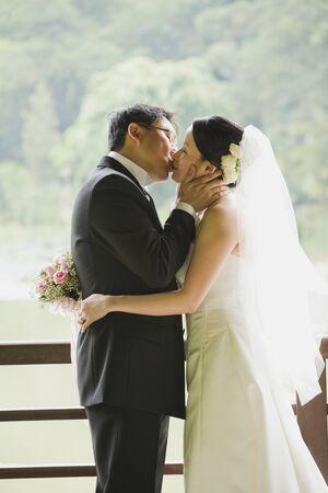tenderly: Bride and Groom Kissing