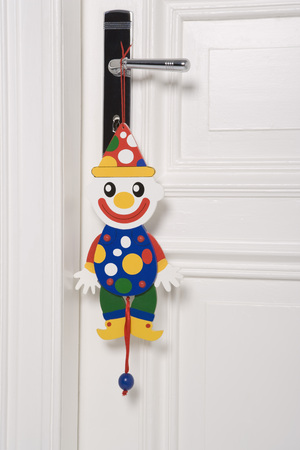 jacks: Clown Marionette Hanging From Door Handle