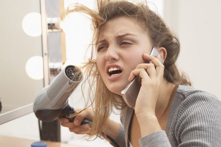 perturbed: Teenager Using Hair Dryer and Talking on Cell Phone