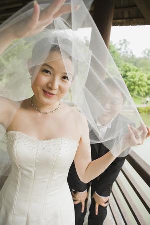 tenderly: Bride and Groom Peeking Through Veil