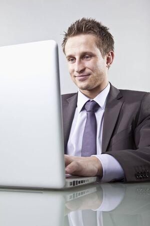 Businessman Using Laptop Computer LANG_EVOIMAGES