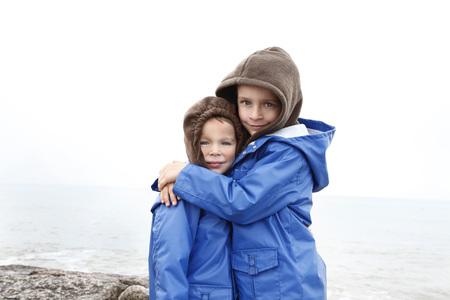 Portrait of Boys Hugging, Jamaica Beach, Galveston Island, Texas, USA