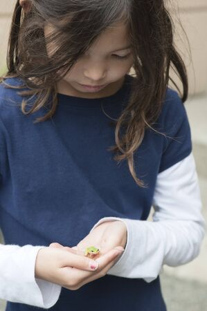 tiny frog: Girl Holding Frog