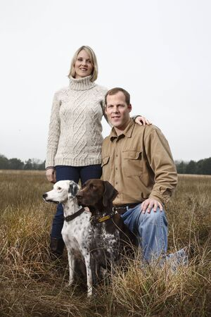 canid: Portrait of Couple With Dogs, Houston, Texas, USA LANG_EVOIMAGES