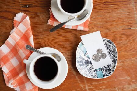 Cups of Coffee and Tip on Cafe Table, Vancouver, British Columbia, Canada