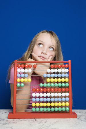Young Girl Counting With Abacus