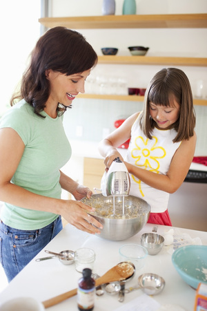 Mother and Daughter Baking Cookies, Portland, Oregon, USA