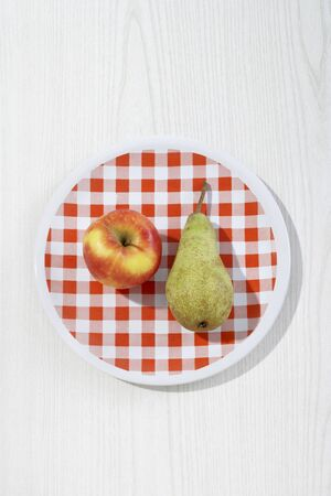 comparable: Apple and Pear on Plate
