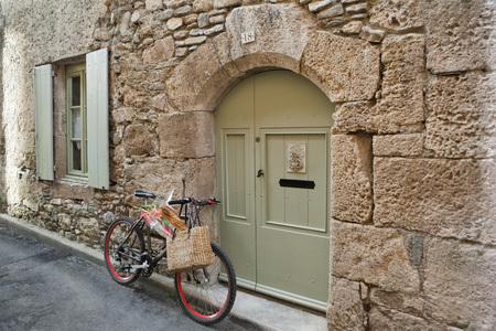 without windows: Bicycle in Medieval Village, Caunes-Minervois, Aude, Languedoc-Roussillon, France LANG_EVOIMAGES