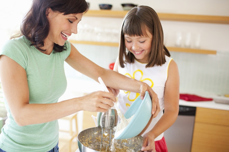 Mother and Daughter making Cookies, Portland, Oregon, USA