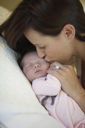 tenderly: Mother Kissing Baby Girl, Burnaby, British Columbia, Canada