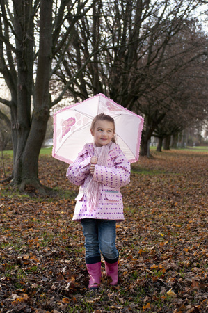 Girl with Umbrella Outdoors LANG_EVOIMAGES