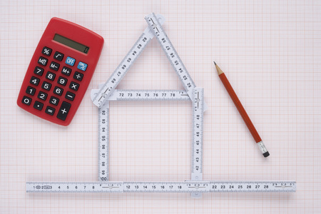 real estate sold: Folding Ruler in Shape of House with Pencil and Calculator LANG_EVOIMAGES