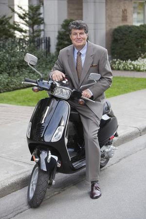 southern european descent: Businessman on Scooter, Montreal, Quebec, Canada LANG_EVOIMAGES