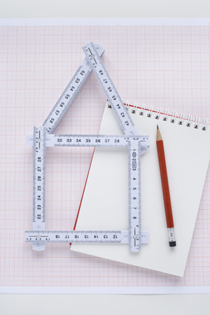 real estate sold: Folding Ruler in Shape of House with Pencil and Notepad