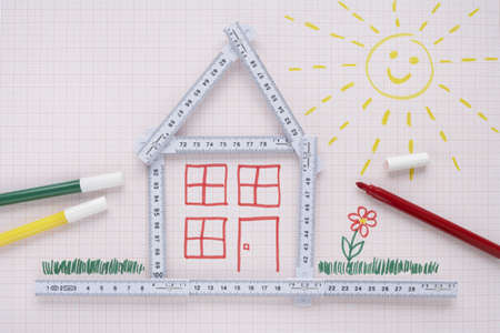 real estate sold: Folding Ruler in Shape of House with Markers