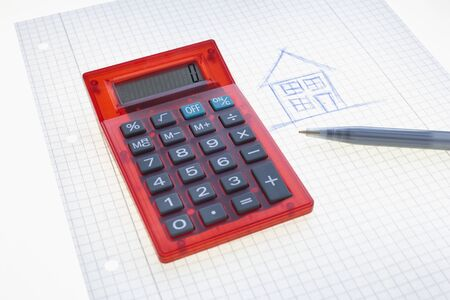 real estate sold: Calculator, Pen, Graph Paper and Drawing of House LANG_EVOIMAGES