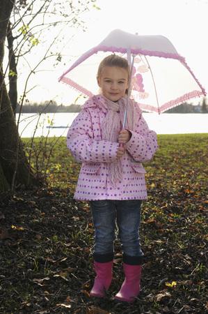 Girl holding Umbrella LANG_EVOIMAGES