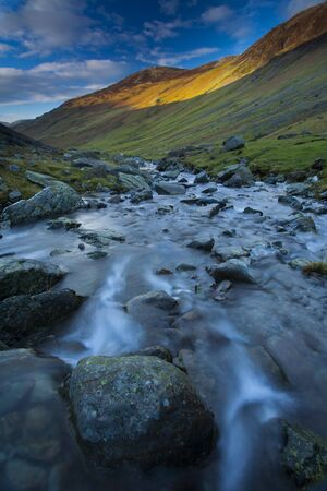 cumbria: Gatesgarthdale Beck running downstream towards Bettermere from Honister Pass, Lake District, Cumbria, England
