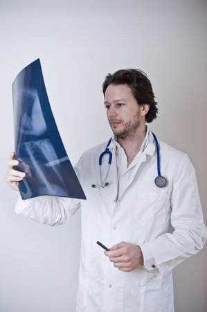 Doctor Checking X-ray LANG_EVOIMAGES