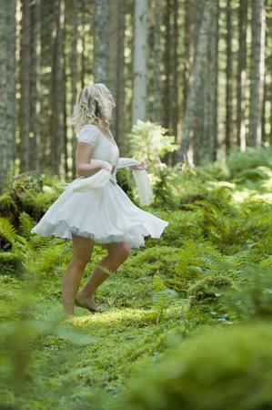 Woman Dancing in Forest, Altenmarkt in Pongau, Salzburg, Austria