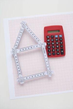 exclusive photo: Folding Ruler in Shape of House with Calculator