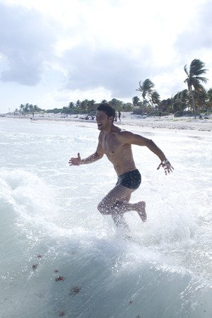 traje mexicano: Man Swimming, Reef Playacar Resort and Spa Hotel, Playa del Carmen, Quintana Roo, Yucatan Peninsula, Mexico
