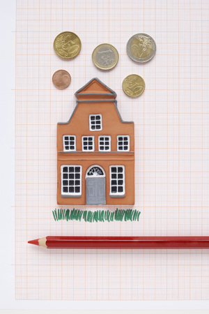 real estate sold: House, Coloured Pencil and Euros on Graph Paper LANG_EVOIMAGES