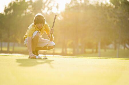 Teenager Playing Golf
