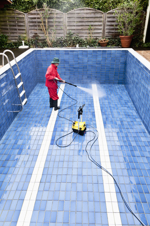 Man Cleaning Swimming Pool, Germany