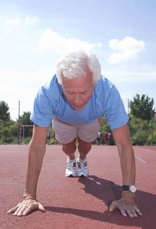 Man Exercising Outdoors on Track