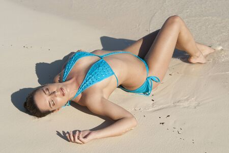 traje mexicano: Woman Sunbathing on Beach, Reef Playacar Resort and Spa, Playa del Carmen, Mexico