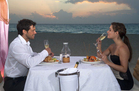 man drinking water: Couple Dining on Beach, Reef Playacar Resort and Spa, Playa del Carmen, Mexico LANG_EVOIMAGES