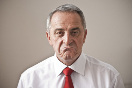 Close-up Portrait of Man Frowning