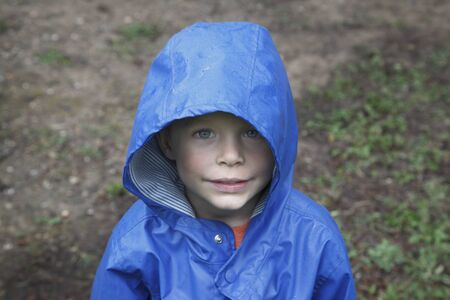 Portrait of Boy in Blue Rain Jacket, Camping at Stephen F. Austin Park, Sealy, Texas, USA