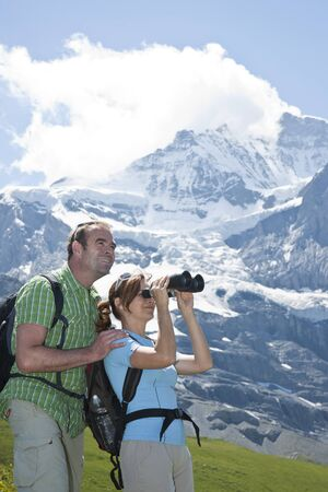 Couple Looking at View, Bernese Oberland, Switzerland