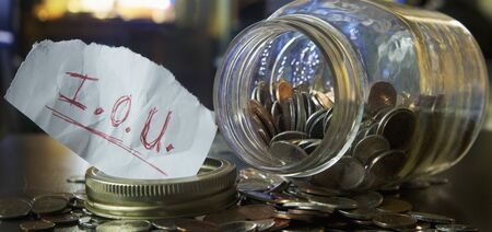 Mason Jar with Coins and IOU Note LANG_EVOIMAGES