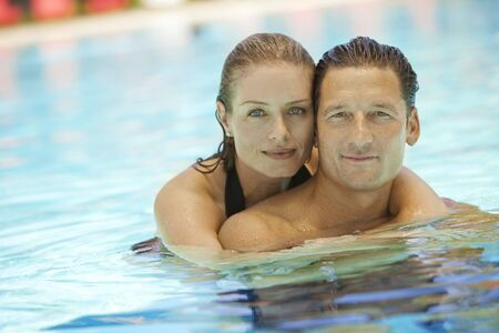 pga: Portrait of Couple in Pool, Palm Beach Gardens, Florida, USA LANG_EVOIMAGES