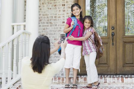 flip flops: Mother taking Photo of Daughters