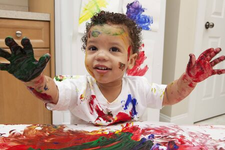 Little Boy Finger Painting LANG_EVOIMAGES