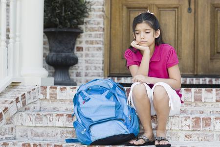 flip flops: Girl with Backpack Sitting on Steps LANG_EVOIMAGES